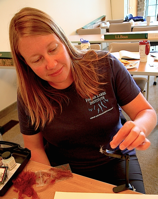 Nadia Harvieux from the Finger Lakes Institute practices tying a new fly pattern. Photo credit: Alberto Rey.
